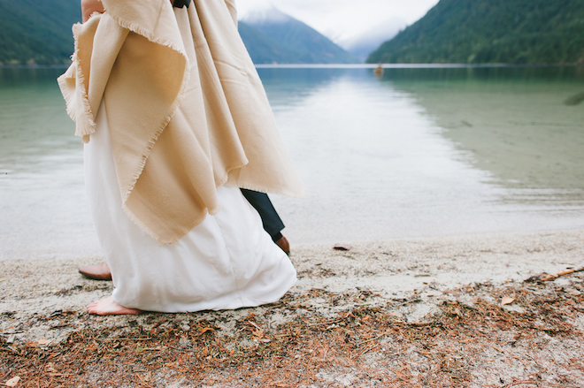 Groom and Bride walk barefoot on beach at Chilliwack Lake Wedding